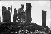 Fon Ndi (r. 192654) at the sacred basalt stone platform overlooking the Kom hills